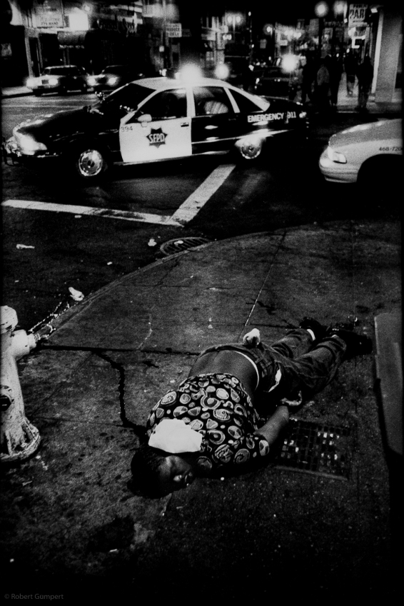 1994-95: San Francisco, CA. Victim of a drive-by shooting, dead at Turk and Eddy. Lost Promise: The Criminal Justice System. 1993-1996 in San Francisco, CA.San Francisco's Tenderloin District, a mix of SROs, public housing, recent immigrants and paroles sits within blocks of Union Square, a center of the city's tourist business. Like similar areas in any city, the Tenderloin has all the urban problems which has resulted in criminal justice become the booming business it is: homelessness, dirt, rundown structures, drugs, violence, prostitution, gangs.