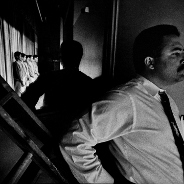 """1995: SF homicide detective provides security during a """"line up."""" Lost Promise - The Criminal Justice System. 1993-1996 in San Francisco, CA. In four parts: Cops in the Tenderloin area; Jail; Homicide; Tournment of Shadows: The Public Defender and the Courts."""